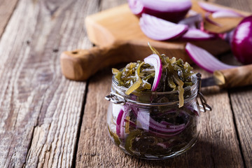 Sea kale salad with red onion in glass jar