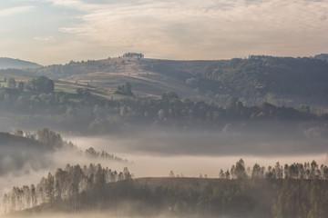 Beautiful mountain landscape of a foggy morning with trees, Dumesti, Alba County, Romania
