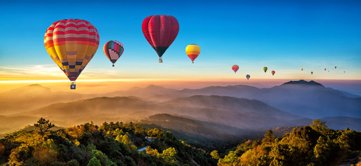 Poster Ballon Colorful hot air balloons flying over mountain at Dot Inthanon in Chiang Mai, Thailand..
