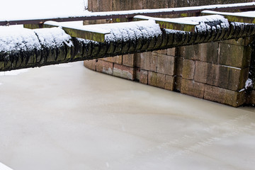 Industrial horizontal pipe over a frozen river
