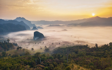 Landscape of misty mountains and sunrise, Phu Langka national park, Phayao province in Thailand.