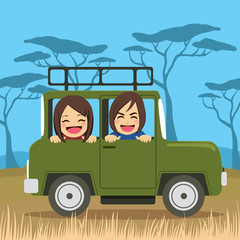 Cute young couple on safari tour vacation riding car happy