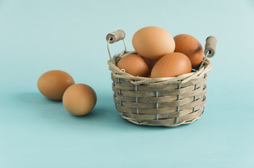 Fresh farm eggs on a delicate background