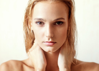 Happy beautiful girl. Nude fashion portrait of a white-haired girl.  Expressive facial expressions .Cosmetology and Spa