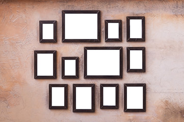 A lot of wooden picture and photo frames stick on vintage wall for house decoration.  Art wall by wooden photo and picture frame vintage style.