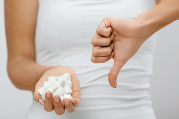 Sugar Is Bad. Woman Holding In Hands Sugar Cubes.