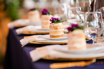 Individual Vanilla Naked Cakes on Navy and Gold Table Place Settings