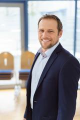 Portrait of smiling man in elegant jacket