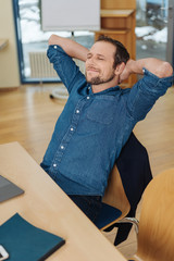 Man leaning back in chair eyes closed