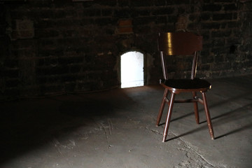 Wooden chair in a dark room