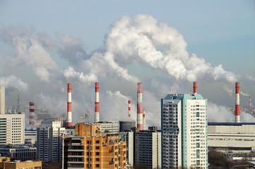 Smoking chimneys of the combined heat and power plant 20. Akademichesky district, Moscow, Russia
