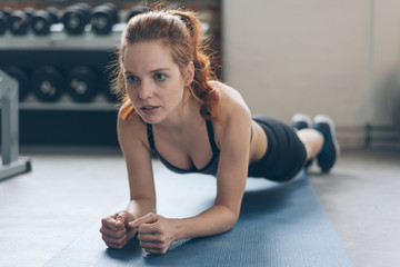 Fit young woman doing exercises in a gym