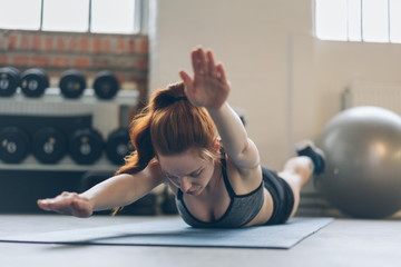 Young woman toning her abdominal muscles