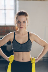 Fit healthy young woman staring intently at camera