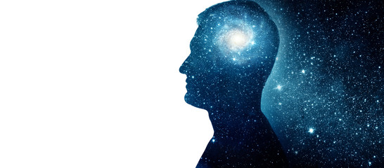 The universe within. Silhouette of a man with the space as a brain. The concept on scientific and philosophical topics. Elements of this image furnished by NASA