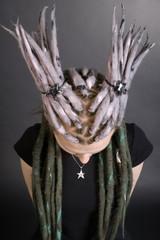Studio portrait of a girl with stylish dreadlocks