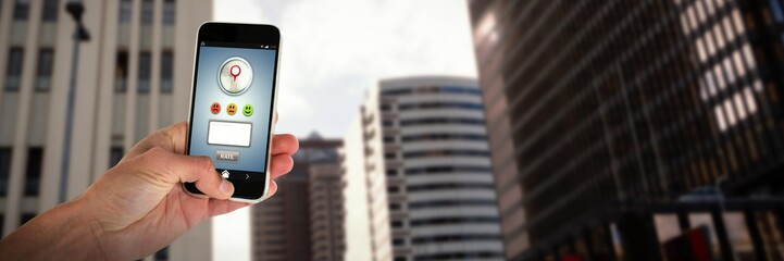 Composite image of cropped image of person holding mobile phone