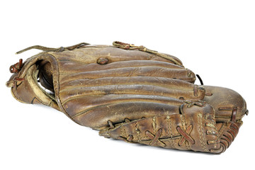 worn baseball glove isolated on white background