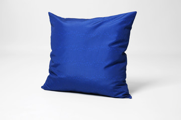 Soft decorative pillow on light background