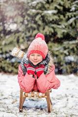 girl on sledge,  Sledding at winter time