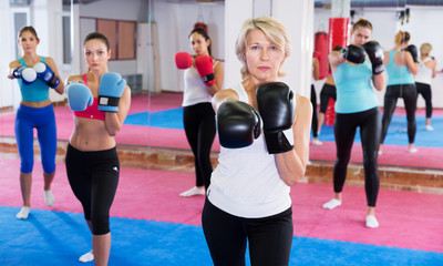 woman who is boxing in group