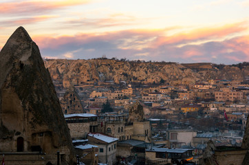 Pink cloudy sunset over the city of Goreme, Cappadocia, Turkey