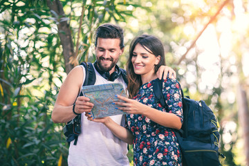 Young tourist couple travel holiday with map