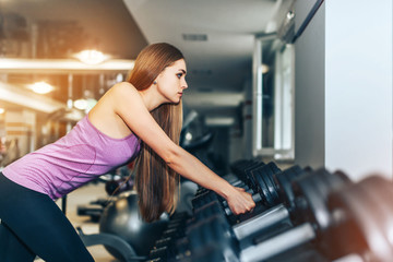 Long hair pretty girl training in the gym