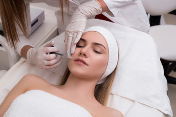 Save your youth! Beautiful young woman getting cosmetic treatmen