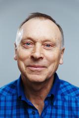 portrait of an elderly man on gray background