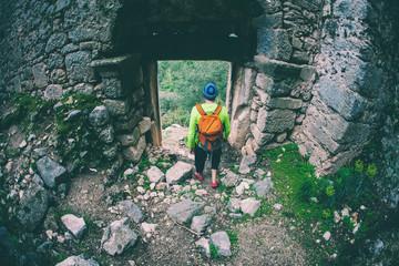 A man looks at ancient ruins.