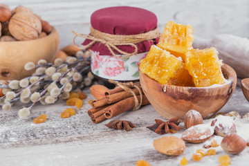 Ingredients for cooking bread or cookies: honeycomb, flour, raisines, mix of nuts, spices