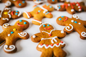 Gingerbread men on white background