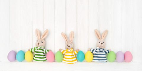 Easter decoration eggs funny bunnies wooden background