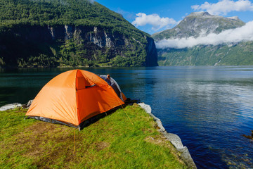 Norwegian fjord landscape with camping tent. Norway adventure.