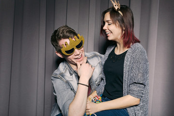 Young beautiful couple having fun posing