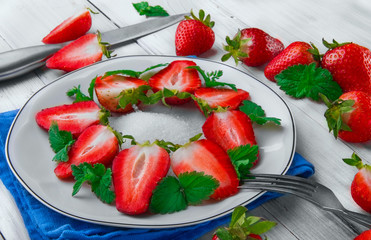 Slice of strawberry with leaf of mint  on white plate beries .Kn