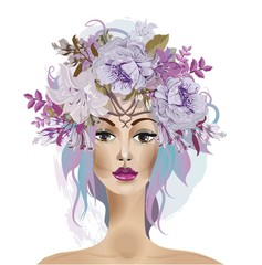 Beautiful girls face with the flower wreath on the head .Symbol of summer