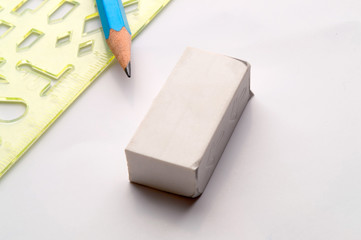 stationery - ruler, an eraser and a pencil are isolated on a white background.