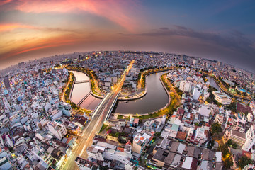 HO CHI MINH, VIETNAM - NOV 20, 2017: Royalty high quality stock image aerial view of Ho Chi Minh city, Vietnam. Beauty skyscrapers along river light smooth down urban development in Ho Chi Minh City Fototapete