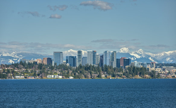 Bellevue, Washington and Cascade Mountains Shine on a Sunny Afternoon across from Lake Washington
