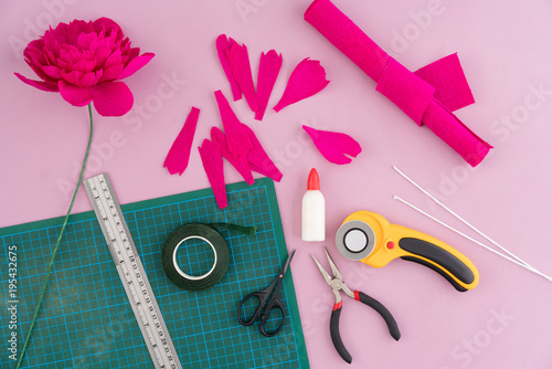Utensils And Tools For Making Crepe Paper Flowers On Pink Wooden