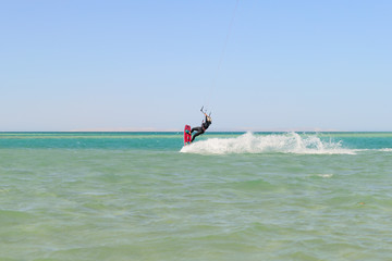 Kiteboarding man on the sea