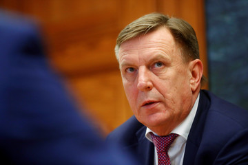 Latvia's Prime Minister Kucinskis speaks during an interview in Riga
