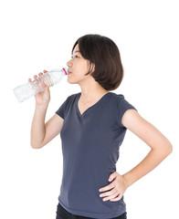 Asian woman drinking bottled water