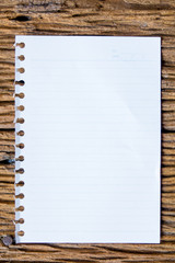 Top view of notebok with pencil, smart phone and calculator on wooden table. Emtry page for text.