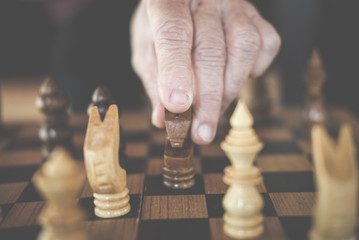 hand playing chess game. business plan & analysis for success. risk & strategy concept