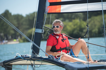 handsome mature man sailing