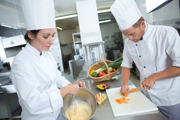 chef and assistant prepare fill for pastries