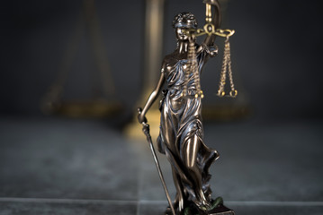 Law and Justice concept. Gray stone background, reflections on the floor, place for typography. Courtroom theme.